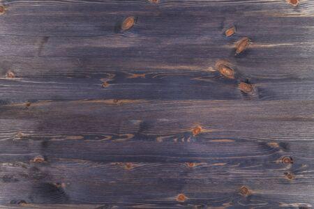 Painted dark blue wooden background. 版權商用圖片