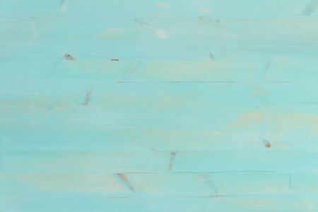 Painted blue wooden background.