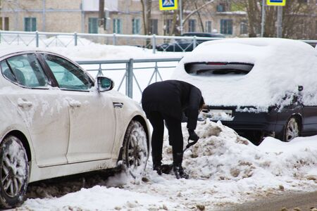 car covered with snow in winter time