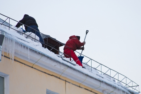Cleaning Snow From The Roof Photo