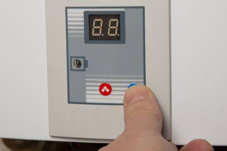 gas furnace: White gas water heater to the wall