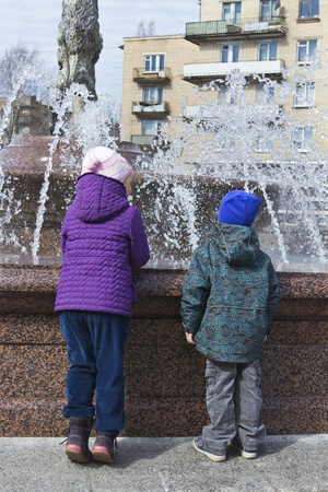 boy and girl looking at the fountain photo