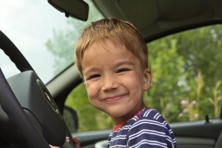 gearstick: European cheerful boy driving a car