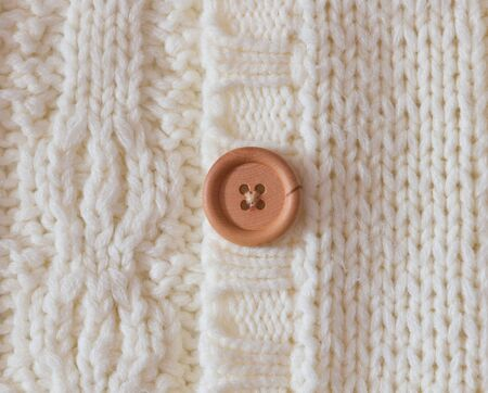 button on a white woolen cloth Stock Photo - 21470989