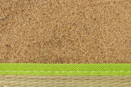 beach mat: beach mat lying on the sand