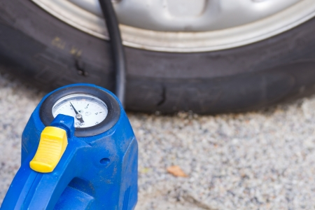filling the air blown out tire car Stock Photo - 22640896