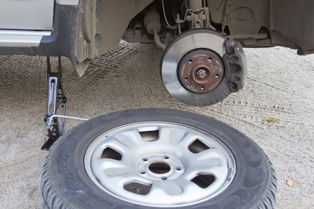 replacing a damaged wheel drive vehicle photo