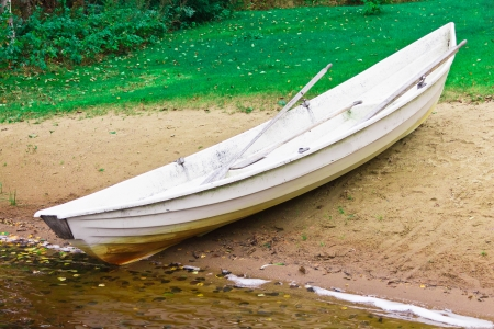 ashore: a rowing boat on the lake Stock Photo