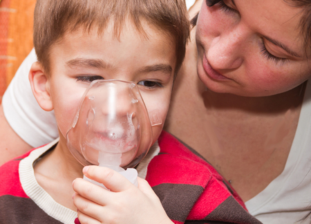treated: European boy treated with a nebulizer