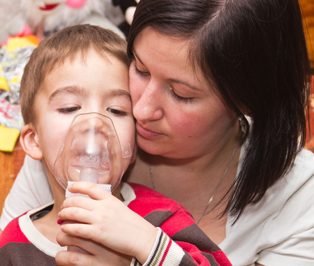 European boy treated with a nebulizer photo