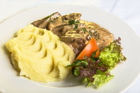 liver with mashed potatoes and vegetables photo