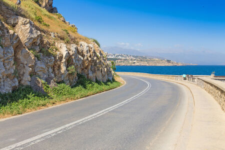 non marking: road-turning on the background of the Mediterranean Sea