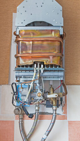 Gas water heater with the casing removed for survey. photo