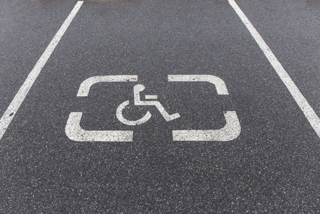 A sign marking a reserved handicapped parking space photo