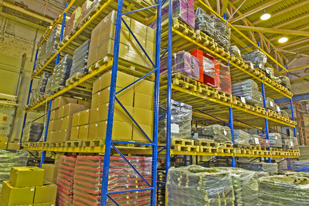 Interior industrial warehouse with products stored on shelves Stock Photo