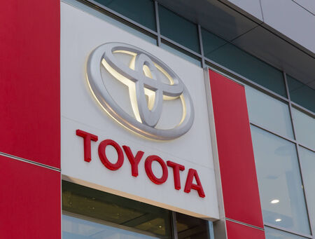 decided: SAINT-PETERSBURG, RUSSIA - January 5, 2015: company logo on Toyota Motor. At first they were sold under the brand name Toyoda, but then it was decided to change the penultimate letter.