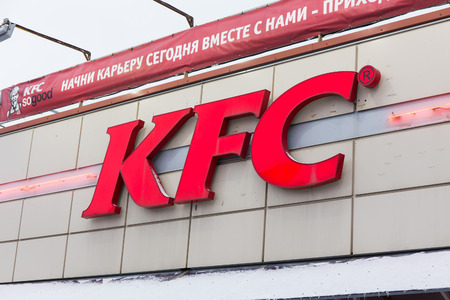colonel: SAINT-PETERSBURG, RUSSIA - January 5, 2015: KFC  company logo on the restaurant building. Colonel Sanders for 12 years created by a huge franchise restaurant chain KFC, which was based on proprietary secret fried chicken in batter. Editorial