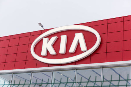 inexpensive: SAINT-PETERSBURG, RUSSIA - January 5, 2015: Kia logo on the building of the showroom. Rich technical equipment basic inexpensive set - characteristic of all models of Kia. Editorial