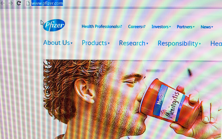 pharmaceutical company: St. Petersburg, Russia - January 19, 2015: Home Photo Pfizer website on the screen.American pharmaceutical company, one of the largest in the world.