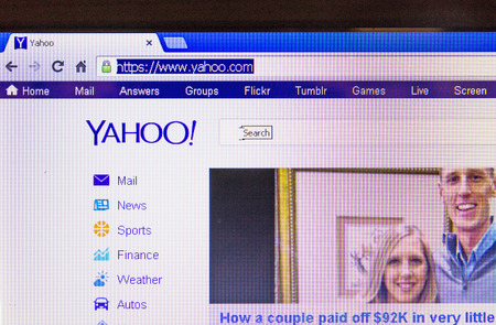 yahoo: St. Petersburg, Russia-January 14, 2014: Photos Yahoo home page on the screen. Is one of the most popular websites in the world.