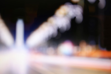 multiple lane highway: Blurred lights of the city at night Stock Photo