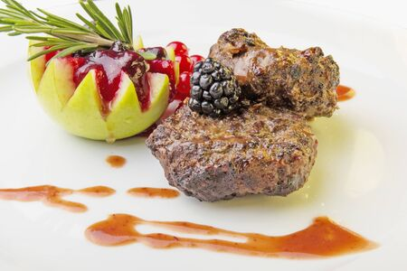 Cutlets bear with baked apple and cranberry sauce photo