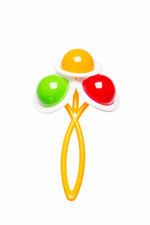 A colorful baby rattle on a white background photo