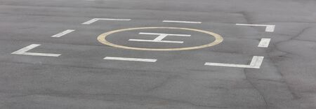 helicopter pad: designated area for landing a helicopter on the tarmac Stock Photo