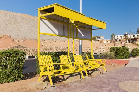sharm el sheikh: Yellow bench on the street of Sharm El Sheikh. Egypt. Stock Photo