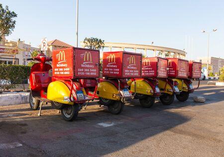 sharm el sheikh: SHARM EL SHEIKH, EGYPT - APRIL 17, 2015: Parking mopeds for delivery of Mac Donalds in the city of Sharm El Sheikh.