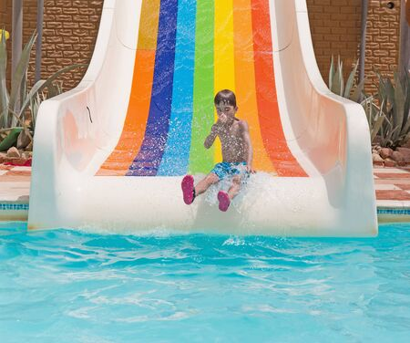 pinched: European boy down water slides with nose pinched Stock Photo