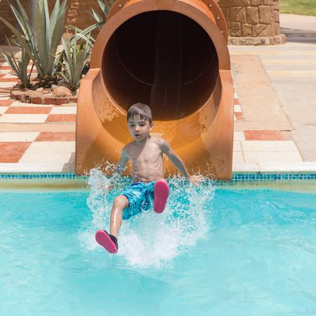 aqua park: European boy down the slides in the Aqua Park