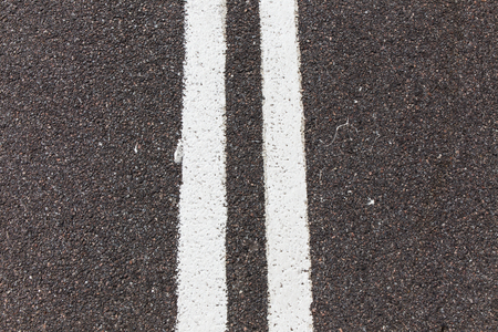 solid line: Asphalt road with white double solid line. Stock Photo