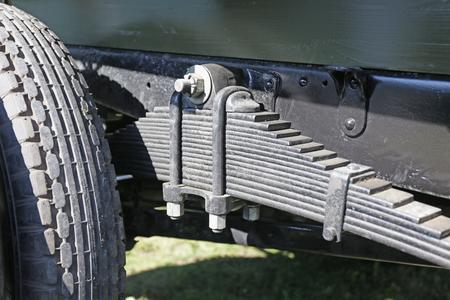 spring leaf: photo of vehicle leaf spring closeup Stock Photo