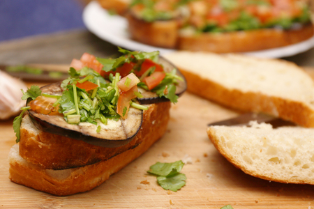 ciabatta: Bruschetta with grilled eggplant and vegetables on ciabatta
