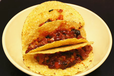 close up food: tacos with beef on a plate