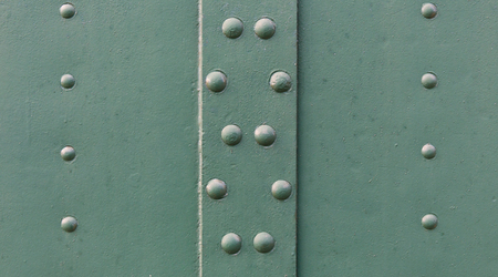 clincher: old painted metal surface with rivets Stock Photo