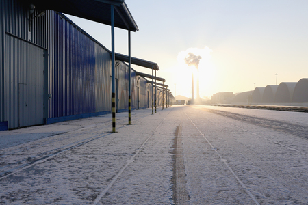 fence: Commercial finished products in the industrial area in the early morning sunrise