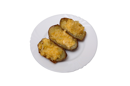 twice: Twice baked potatoes cooked with cream cheese, Parmesan cheese and spices. Rustic style. Popular American dishes. Isolated on white.