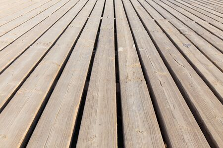 floorboards: wooden floorboards diagonally stretching into the distance