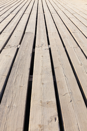 diagonally: wooden floorboards diagonally stretching into the distance