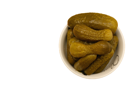 gherkins: Pickled gherkins in a small white plate isolated on white
