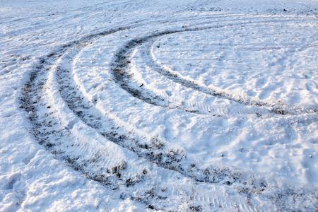atv: ATV circular marks on the snow