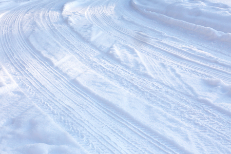 ski traces: curve from the wheel tracks on the snow Stock Photo