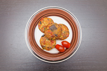 galettes: vegetable galettes from courgettes, tomatoes and sweet peppers Stock Photo