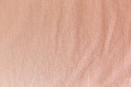 crumpled sheet: Pink fabric texture. crumpled sheet close up