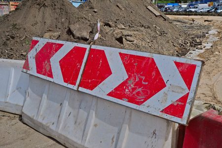 rotational: warning sign on the rotational direction of the plastic road barriers