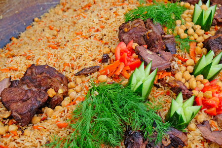 Asian rice dish with meat. Pilaf close up Stock Photo