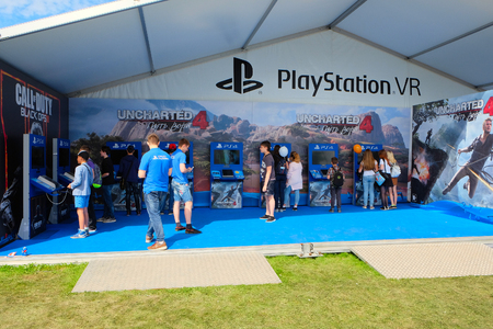 sony: Saint Petersburg, Russia - July 17, 2016: young people get acquainted with the new gaming products of the sony company