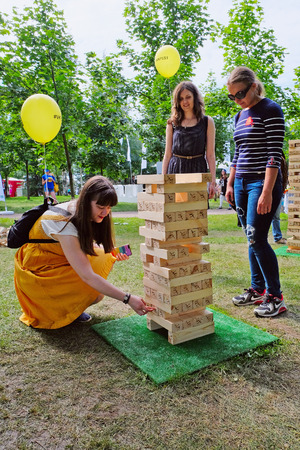 Saint Petersburg, Russia - July 17, 2016: girls playing jenga in the city Park Editorial